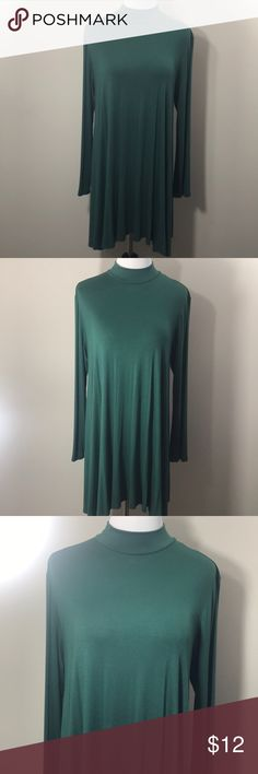 """Emerald Green Tunic Dress Flowy Long Sleeve • Emerald green long sleeve tunic dress 😍 • Brand: Vanilla Bay • Worn a couple of times but lots of pretty life left ✨ • Would be awesome for Christmas dinner • Not sure on size so I've included the measurements below {I ripped out the inner tag 🤦🏼♀️... it's either a small or a medium} • Armpit to armpit: 19"""" • Top of neck to back bottom: 31"""" • Armpit to side length: 23"""" Vanilla Bay Tops Tunics"""