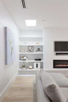 This living room skylight adds so much light to this modern living room with gas fireplace. #livingroomdiy