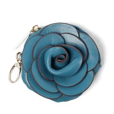 A rose by any other name may not be as sweet. The Rose Coin Purse features a handmade spiral of bright leather petals with a zipper pocket and clip to easily attach to bags. It instantly adds an eye-catching accessory and keeps small items handy. Look gorgeous on the go.
