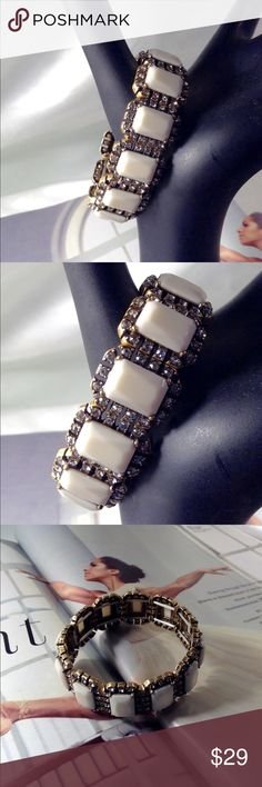 Ivory Cabochons-Rhinestone Bracelet This gorgeous vintage feel stretch bracelet features white cabochons on a burnished gold setting with tiny rhinestone accents. All jewelry is shipped in its own jewelry box for safety. (This closet does not trade or use PayPal ) Son Paises Jewelry Bracelets