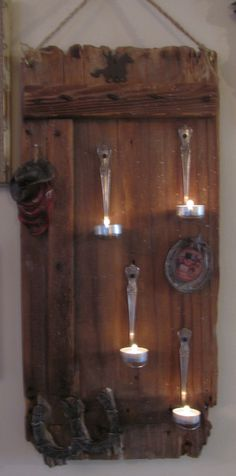 the spoon Tealight Candle holder. an old small door Sprayed a clear semi gloss finish on it . the spoon are Vintage silver table spoons . i think Soup spoons would work better. Western Decor, Country Decor, Rustic Decor, Tea Light Candles, Tea Lights, Silver Table, Small Doors, Western Homes, Tealight Candle Holders