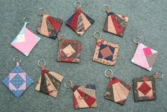 Great idea: Key Chain Quilts using patterns from foundation paper piecing.  They are less than 2 inches square and are perfect for key chains or zipper pulls.