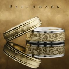 6mm 14K yellow gold men's wedding band with a satin center and a milgrain edge | RECF7601SY | 8mm 14K white gold men's wedding ring with a 14K yellow gold tree bark center | CF818388WY | #benchmarkrings #ring #rings #diamonds #diamond #fiance #weddingring #bling #wedding #gold #gettingmarried #theknot #shesaidyes #jewelry #engaged #engagementring #marryme #fashion #mensfashion #love #style #madeinamerica #beautiful #bride #groom #luxury #art #lovestory #womensfashion #engagement