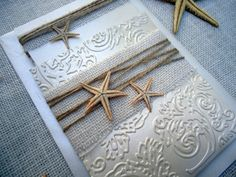 Destination Wedding Invitations in brilliant cardstock with white burlap, starfish and the embossed with floral reliefs. It's Elegant and unique for a special day :)