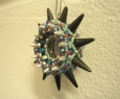 Finally dared to try my hand at this. Spike Wheel Pendant. Design Sabine Lippert.