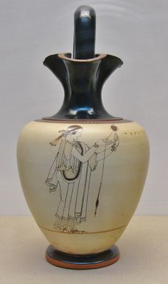 White ground jug made in Athens in the early 5th Century BC. The woman is depicted spinning cloth. This is one of the finest Attic white ground vases I've ever seen. The British Museum, London.