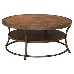 •  Easy to maneuver around, this coffee table brings your seating area together in a round-about way. A rustic mix of metal and wood merge on the table's expansive tabletop and lower shelf.  Signature Design by Ashley is a registered trademark of Ashley Furniture Industries, Inc.