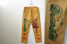 vintage 70s Big E Levis Groovy Printed Silhouette Faces, Hearts and Phrases Khaki Pants. $525.00, via Etsy.
