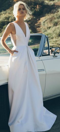 Low back wedding dress with pockets made from couture silk with hand pleated panels