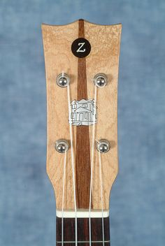 "Gary Zimnicki's ""Reclaim Detroit"" soparno ukulele made from reclaimed timbers and floorboards from an abandoned Detroit house. Gorgeous."
