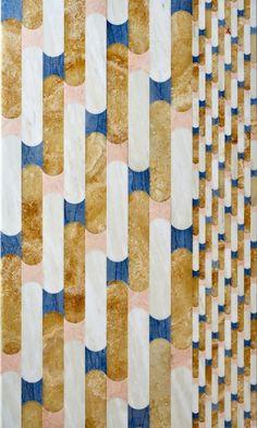 Grandi rotoli a parete intarsiati in marmo