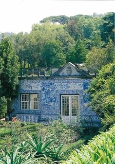 Blue & White goes extreme home...  'A House covered in Portuguese Tiles'!