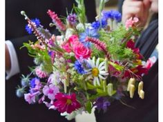 A high-summer bouquet by Real Country Flowers, containing more than 30 different varieties of flowers, herbs and grasses. www.realcountryflowers.co.uk