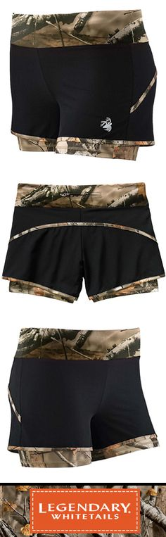 "Ladies' Sunset Performance Shorts will turn some heads at the gym! These stylish performance shorts are made from a poly/spandex blend featuring Big Game Camo® accents and a light compression brief. These lined workout shorts for women also have a comfortable elastic waistband and a back zippered pocket. Inseam for knit liner is 3-1/2"" to 4-3/4""."