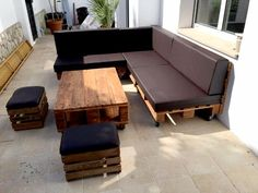 DIY Sofas and Couches - Pallet Sectional Sofa With Black Cushion - Easy and Creative Furniture and Home Decor Ideas - Make Your Own Sofa or Couch on A Budget - Makeover Your Current Couch With Slipcovers, Painting and More. Step by Step Tutorials and Instructions http://diyjoy.com/diy-sofas-couches