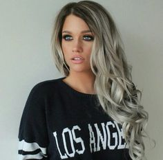 Gorgeous girl !! With perfect long wavy....greyish hair.....she is totally rocking this look !!