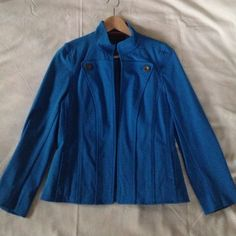 Bright blue blazer Nina McLemore Bright blue high collar blazer. Durable material and cool front button detailing. This is an open style jacket so there are no buttons/loops to close it. Color is true to life. (It's really just like the color of the little blue dot I selected in the listing details area). Size 2, could also fit a 4. Excellent condition. Nina McLemore Jackets & Coats Blazers