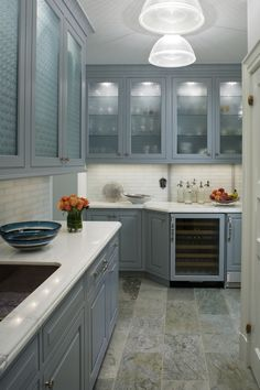 Image The Possibilities in this beautiful #blue #kitchen with subway tile backsplash and ice green slate flooring #connecticutstone