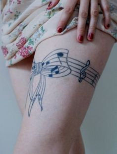 I've always wanted (since high school, in fact) music notes on my wrist, but it might be better to have it on my leg. After all, I can hide it from employers that way!