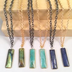 "Gemstone Bars just arrived!  Labradorite, Peruvian Amazonite, and Lapis Lazuli. Your choice of Gunmetal or Gold Chain at 34"". Rectangular gemstone bar is 2"" and reversible.  Love this for gift giving - be sure and get one for yourself too!  Limited Supply"