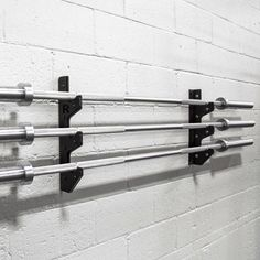 Rogue's 3 Bar Gun Rack mounts easily to any solid wall (concrete, cinder block, wood, etc), offering a simple solution for barbell storage. Get yours today!