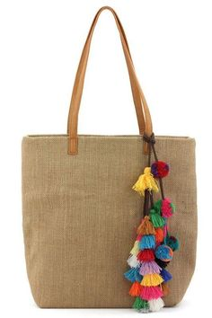 This is a MUST have Tote bag for this spring & summer season. It features a linen material, colorful threaded pom pom & tassel details, one inside compartment, 2 small pouches and a zippered pocket wi Mais Sacs Tote Bags, Reusable Tote Bags, My Bags, Purses And Bags, Designer Totes, Jute Bags, Boho Bags, Fabric Bags, Handmade Bags