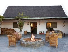 Country house with fire pit and Spanish / Texas Ranch flair - White stucco building exterior#firepit #garden