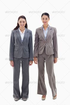 Two businesswomen smiling ...  19s, 20s, Two People, adult, associate, background, beautiful, blank, body, business, businesswoman, by, caucasian, coworker, employee, executive, full, happy, mixed-race, partner, pretty, professional, secretary, service, side, smile, smiling, standing, suit, team, teamwork, white, woman, work, young