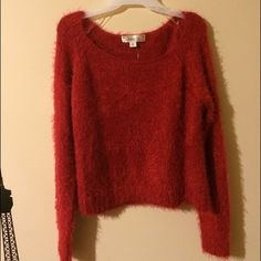 New!! Deep red fuzzy sweater New and super comfy red sweater. It has a fuzzy texture and a light tinsel shimmer. Also  somewhat cropped I think! Never been worn! Decree Sweaters Crew & Scoop Necks