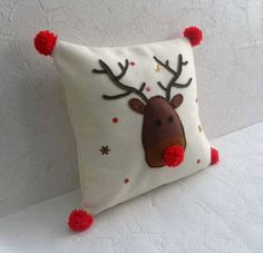 You've found the perfect cushion to decorate your home this Christmas. The Rudolf Christmas cushion is just adorable, handmade in Derbyshire. Handmade pom poms make this cushion just perfect!