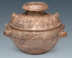 Lotus petal guan jar recovered from tomb M3, a 1700 year old Silk Road tomb in the Chinese city of Kucha.