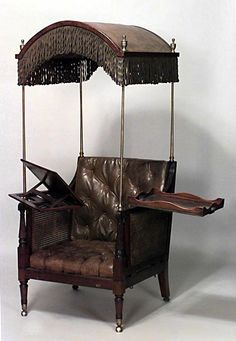 English Regency style (19th Cent) hooded mahogany and leather library armchair with adjustable chaise attachment. And, a tray for refreshments