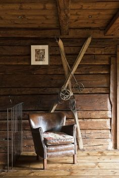 Chalet - vintage skis, battered leather chair - perfect. Interesting solution for the mezzanine protection in metal