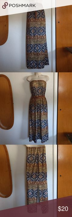 """Uncivilized Brand Dress/Skirt Combo Versatile outfit - Can be worn as strapless Dress or as a skirt.   Pretty patterns, gold's, blue, browns and cream. Slit can be in back, side or front. Fabric is strechy. Waist is 14"""", length from top to bottom of hem is 42"""".   Braided belt with fringe ends can be doubled or used as single length. Uncivilized Dresses"""