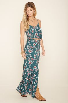 A woven maxi skirt with a buttoned front, shirring along the hem, and an allover floral print. Matching top available.