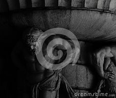 Shot in black and white, detail on some male figures holding a fountain on the garden, Set in Aranjuez, Madrid, Spain
