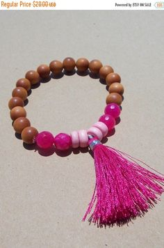 Aromatic #sandalwood beads with the perfect touch of summer added. Bubblegum pink agate and light pink wood beads go beautifully with the bright pink tassel.   *Fits most wr... #meditation #prayer ➡️ https://www.etsy.com/listing/453051012/sale-pink-tassel-bracelet-sandalwood?utm_campaign=products&utm_content=c8e53035ec7045fbaae631d33baaf510&utm_medium=pinterest&utm_source=sellertools