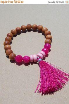 Aromatic #sandalwood beads with the perfect touch of summer added. Bubblegum pink agate and light pink wood beads go beautifully with the bright pink tassel.   *Fits most wr... #meditation #prayer ➡️ https://www.etsy.com/listing/453051012/sale-pink-tassel-bracelet-sandalwood?utm_campaign=products&utm_content=c8e53035ec7045fbaae631d33baaf510&utm_medium=pinterest&utm_source=sellertools