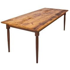 This high end Reclaimed Barn Wood Farm Table is handcrafted in Vermont. With its traditional Tear Drop legs this unique farm table is a country home treasure! Table top is custom made in Vermont from high quality antique white pine or chestnut from reclaimed and recycled antique doors, floor boards, siding and other original components of New England's historic barns.