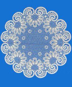 A round doily is made of Russian bobbin lace. #Russian #bobbin #lace