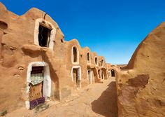 Pictures of The Ksar Hedada, Tunisia. Built as fortified grain stores on the edge of the Sahara so that when the Camel trains returned after a 4 month found trip across the Sahara to trade precious goods there would be food to eat.  Ksar Hedada was used as a Star Wars film set