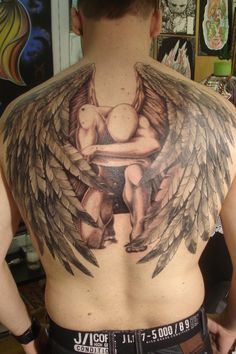 Angel Tattoo Design For Men - http://tattooideastrend.com/angel-tattoo-design-for-men/ -