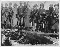 Twisted Footnote to Wounded Knee: On December 29, 1890, in a ravine near Wounded Knee Creek, South Dakota, the U.S. Army, supported by American Indian mercenaries, slaughtered approximately 300 Lakota men, women and children—75% of Big Foot's Lakota community. They had already surrendered when they were brought to Wounded Knee by the army. The U.S. troops turned their weapons—including 4 rapid-fire Hotchkiss guns—against clearly defeated warriors and innocent women, children and old men.