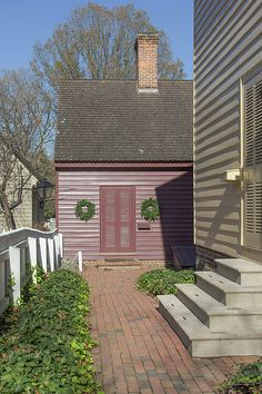 A brick path leads to the kitchen behind Nicholson Store in Colonial Williamsburg, Virginia