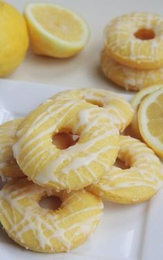 Baked Lemon Cake Donuts Recipe ~ Fluffy & Moist - - Full of fresh lemon flavor these homemade baked lemon cake donuts are fluffy, moist and easy to make. Lemon glaze takes this lemon donut recipe over the top! Delicious Donuts, Delicious Desserts, Yummy Food, Healthy Donuts, Tasty, Beignets, Köstliche Desserts, Dessert Recipes, Quick Dessert