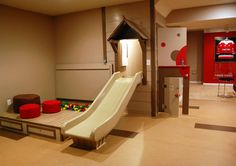 Awesome playhouse/slide/ball pit in a family's basement media room.  Very cool.