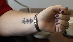 This tattoo marks the date this woman began treatment for her breast cancer.  http://thestir.cafemom.com/healthy_living/145399/20_awesome_tattoos_supporting_breast