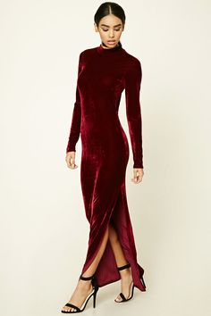 A velvet maxi dress featuring a back cutout, high neckline, long sleeves, and a side slit.