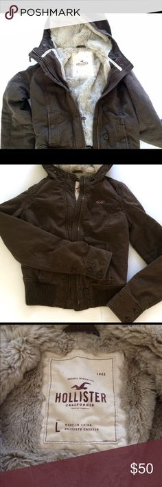 Hollister Brown Bomber! Super cute hooded bomber with very little wear! EUC. Features zipper and button closures and soft Faux Fur lining. Warm and cozy but also a great early spring or fall coat! Size large but runs small. Hollister Jackets & Coats