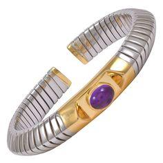 "Bulgari Cabochon Amethyst Steel Gold Flexible Bangle Bracelet. A beautiful Bulgari 18k yellow gold and steel flexible slip on bangle bracelet with a cabachon amethyst center.  Signed ""Bvlgari"" and numbered, 21st century"
